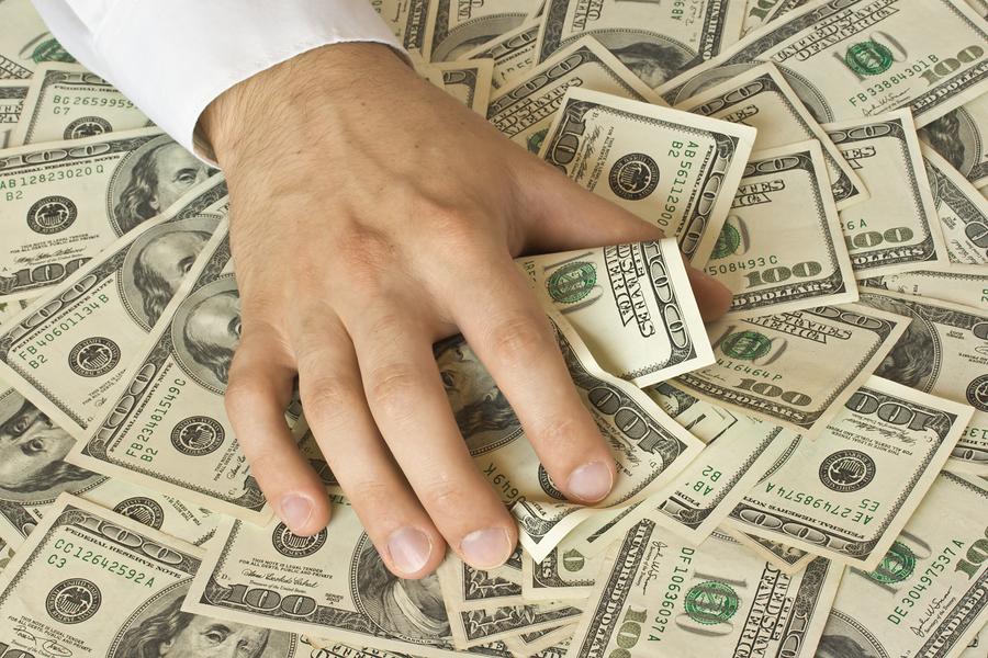 bigstockphoto_greedy_hand_grabs_money_2405774_5fh3.jpg